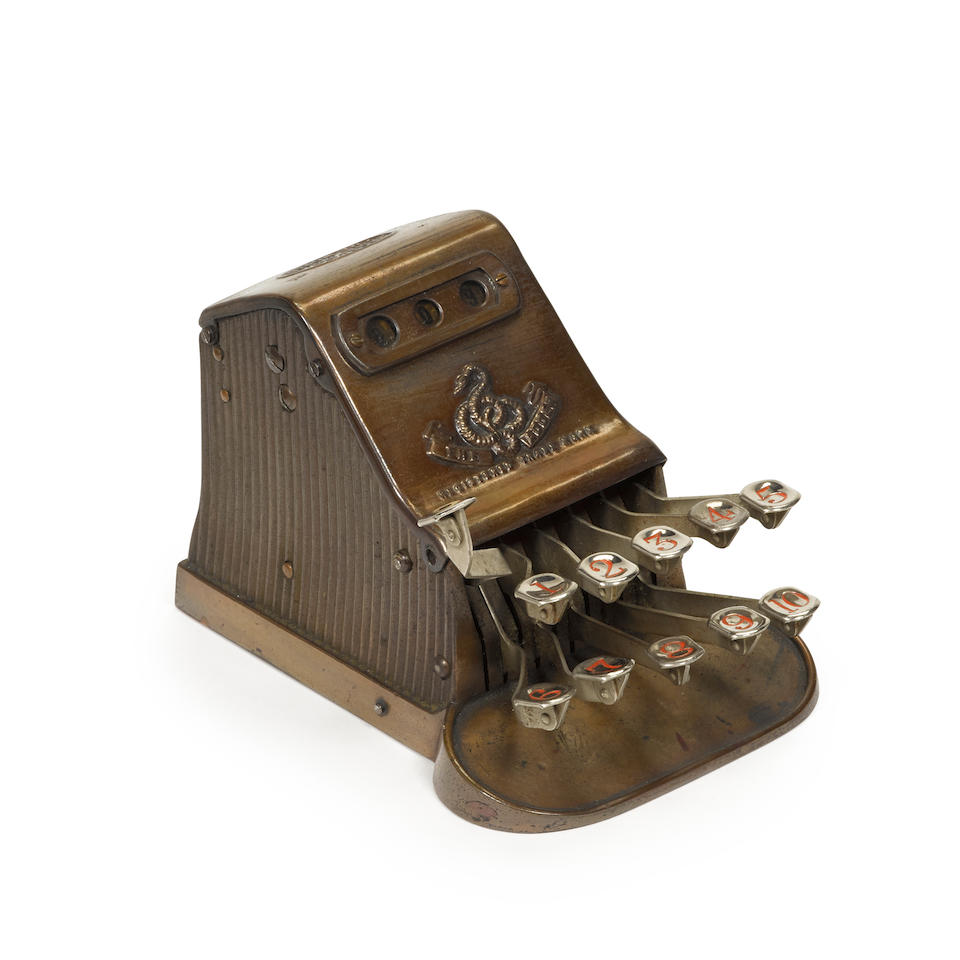 THE ADDER KEYBOARD CALCULATION MACHINE No 6243, London: The Adder Cash Register Syndicate Ltd, c.1903, with 2 rows of 5 keys from 1-10, zero key, 3 window display, case in brushed finished shaped metal over cast metal,