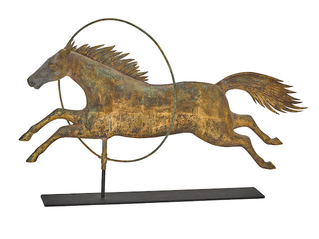 A FINE MOLDED GILT COOPER HORSE JUMPING THROUGHOUT HOOP WEATHERVANEAttributed to A. L. Jewel & Co., Waltham, MA, third quarter 19th century