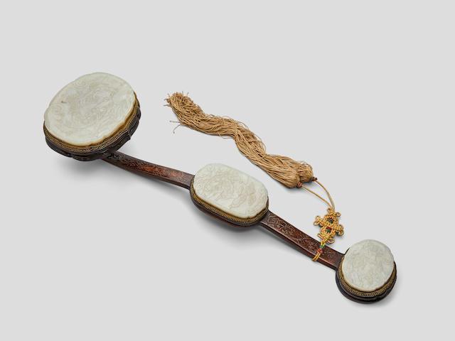 A jade mounted wood ruyi scepter