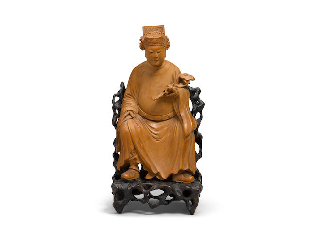 A boxwood seated figure of a Wenchang Qing dynasty