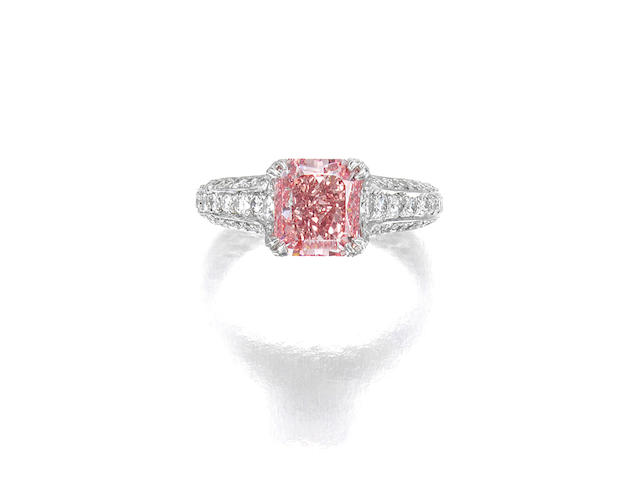 AN ATTRACTIVE FANCY COLORED DIAMOND AND DIAMOND RING
