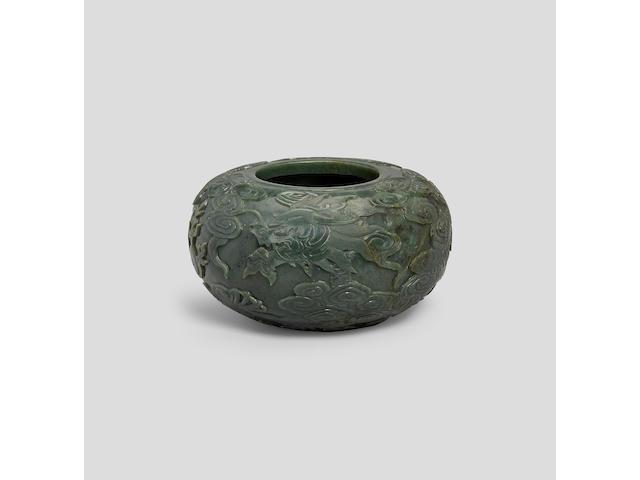 A Spinach-green jade dragon alms bowl  Qing dynasty