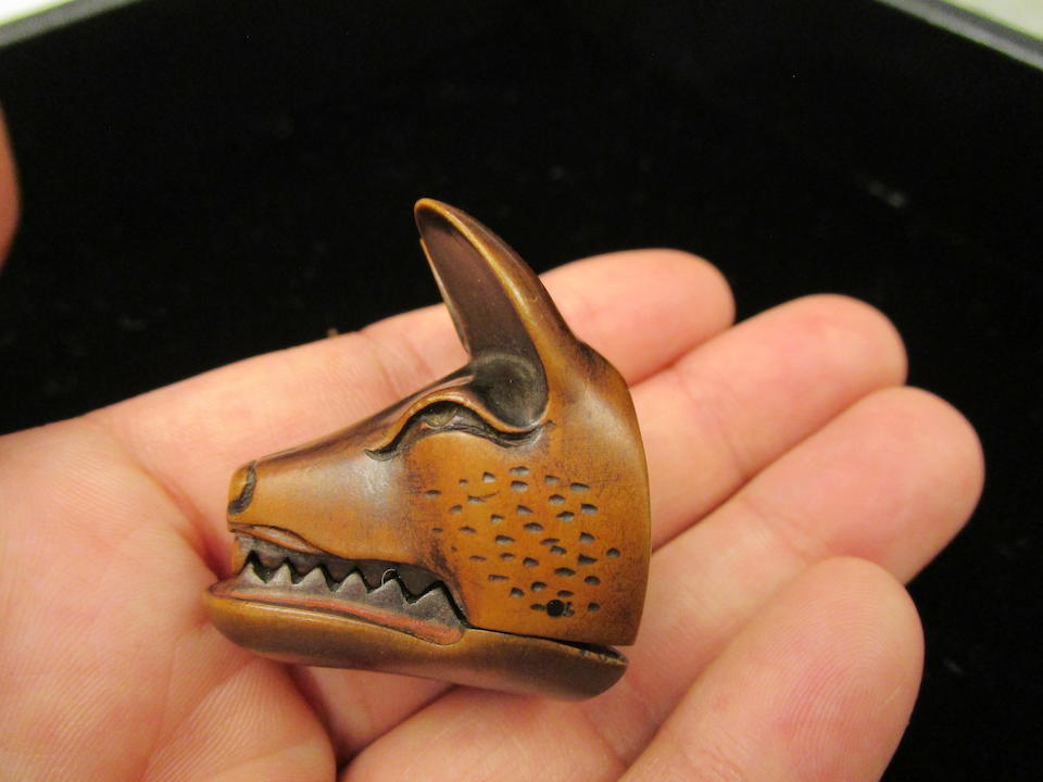 Deme Uman (active early 19th century) A wood mask netsuke of foxEdo period (1615-1868), early 19th century