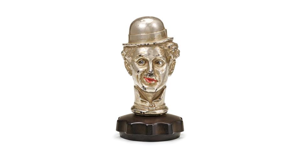 A rare 'Charlie Chaplin' car mascot, American, 1920s,