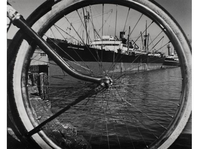 Ruth Orkin (1921-1985); Through My Bike Wheel at 16, San Francisco;