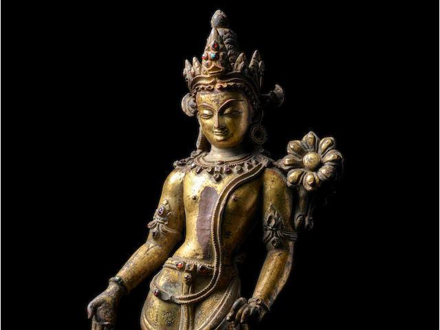 A GILT COPPER ALLOY FIGURE OF LOKESHVARA PADMAPANI  NEPAL, 13TH CENTURY