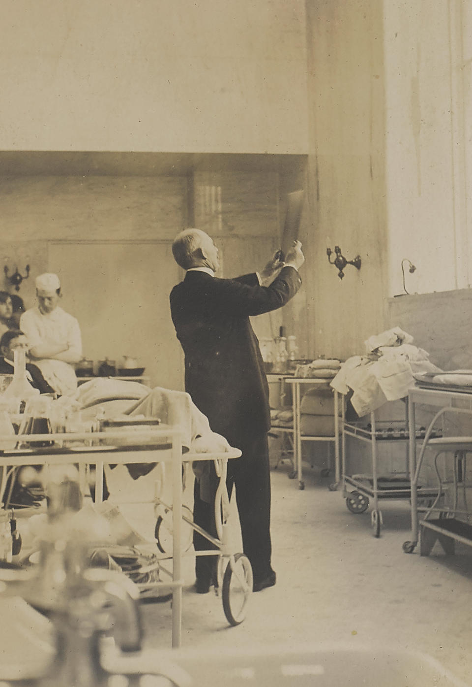 JOHNS HOPKINS HOSPITAL: PHOTOGRAPHY ALBUM. Album containing 60 photographs, mounted 1 per page on black paper, gelatin silver prints, each roughly 98 x 75 mm, 1903-1904, of the original staff in the early years of Johns Hopkins Hospital,