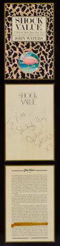 A Russ Meyer display of John Waters' book, Shock Value, signed by Waters