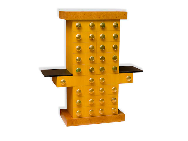 Ettore Sottsass (1917-2007) Mobile Giallo Chest of Drawers (from the Bharata Collection)1988produced by Design Gallery Milano, stained birch, ebonized ash, burl veneers, gold leafheight 57 1/2in (146cm); width 52in (132cm); depth 18 1/2in (47cm)