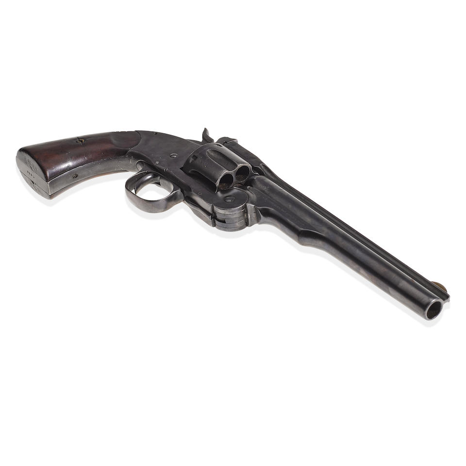 SMITH & WESSON SCHOFIELD REVOLVER ATTRIBUTED TO JESSE JAMES. Serial no. 2921, circa 1875, .38 caliber 7 inch barrel with fluted sighting channel German silver sight.
