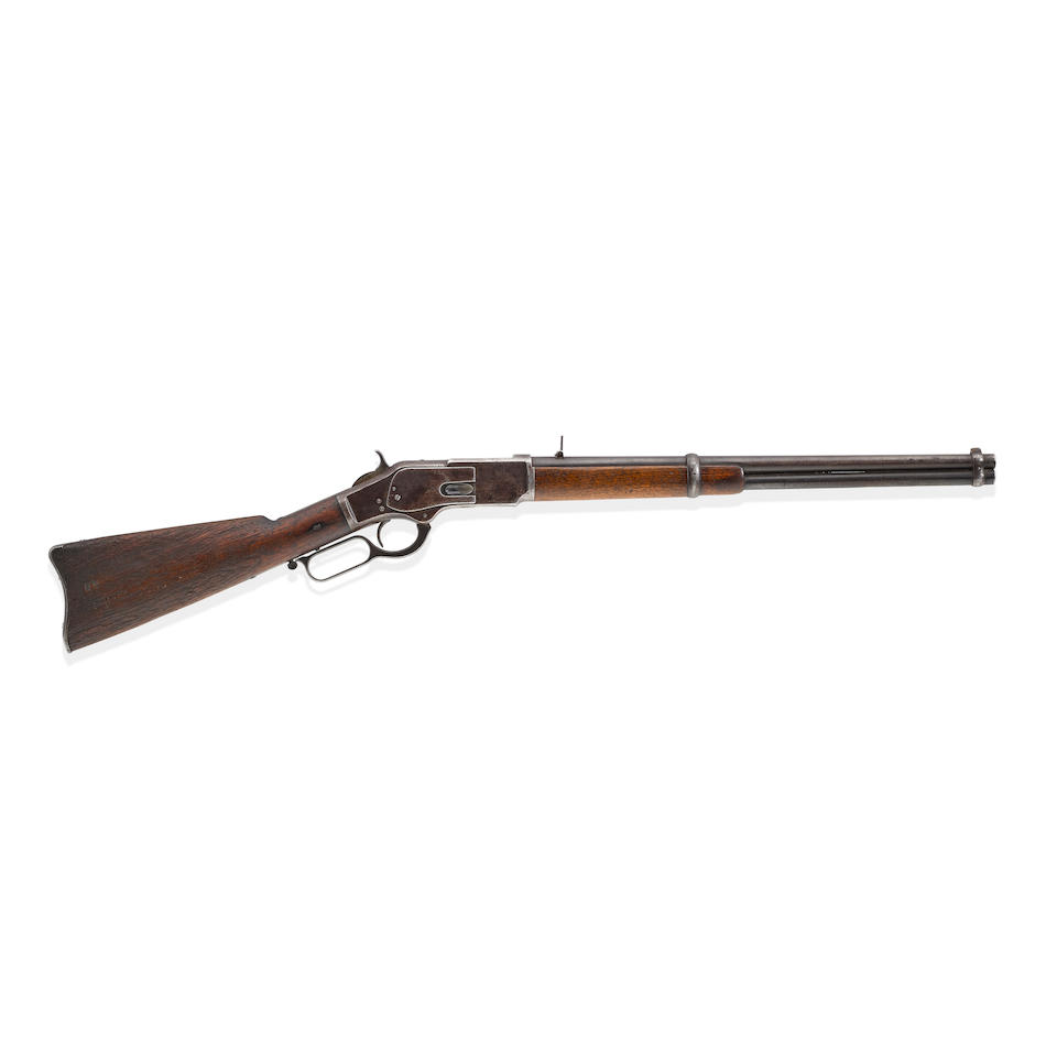 BILLY THE KID'S WINCHESTER 1873 WHICH HE STOLE FROM THE LINCOLN COUNTY COURTHOUSE DURING HIS DRAMATIC ESCAPE. Serial no. 20181 for 1876, 20 inch round barrel folding rear-sight blued finish.