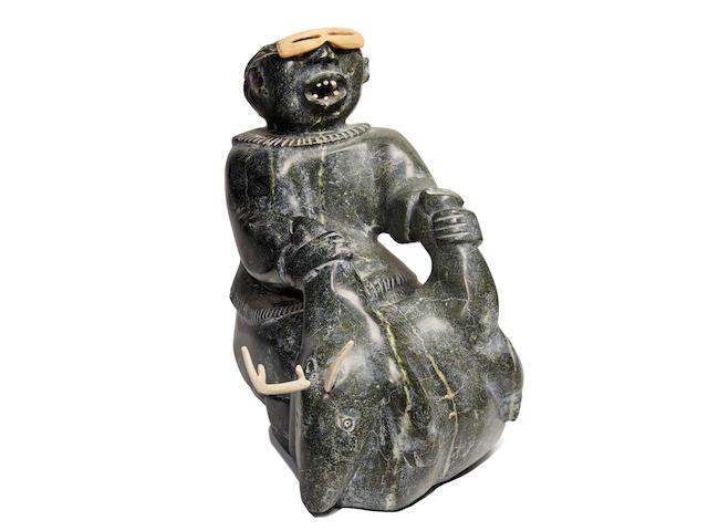 "A Judas Ullulaq sculpture, ""The Caribou Hunter"""