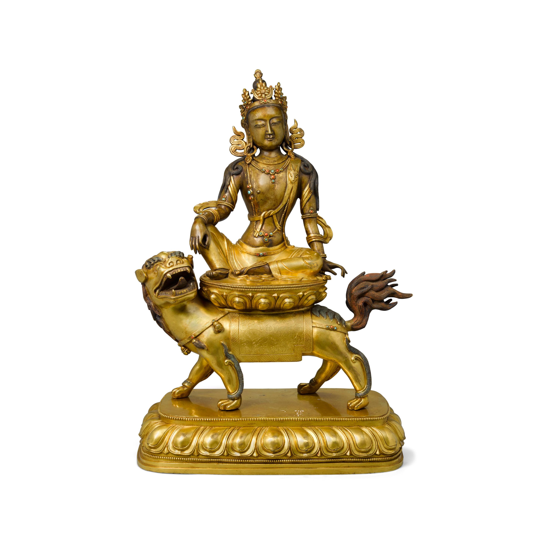 A gilt bronze figure of manjushri Circa 1900 or later  (2)