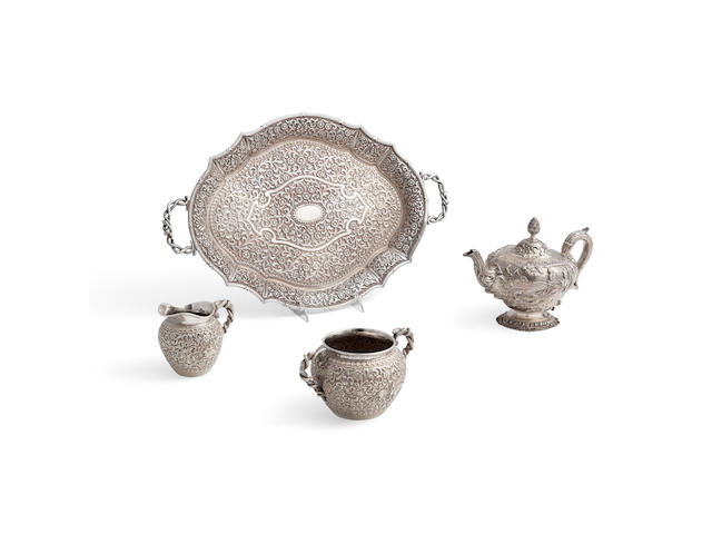 AN INDIAN SILVER FOUR-PIECE TEA SERVICE by Oomersee Mawjee & Sons, Bhuj, Kutch, circa 1920